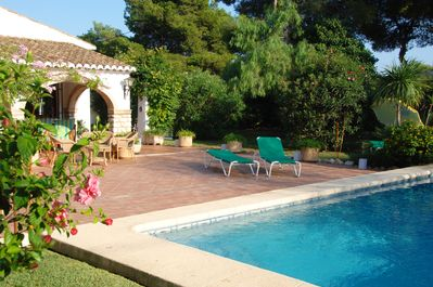 Lay by the beautiful pool on the spacious patio and well established garden.