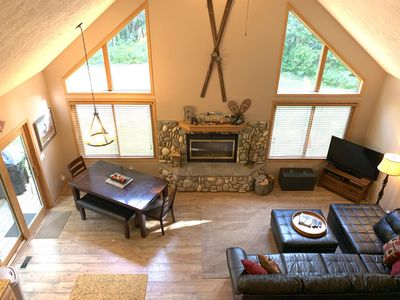 """Two Story Great Room with views of Betsie River & 50"""" Smart TV."""