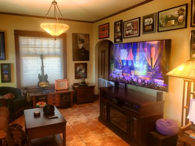 """Living room 70"""" UHD TV with big cable package!"""