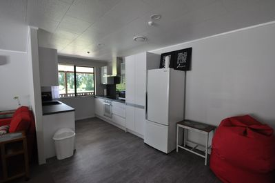 Full kitchen with oven, stove, microwave, dishwasher, fridge freezer and more