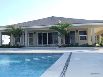 Elegant Beachfront Home nearby Sandals Emerald Bay Exuma, Bahamas