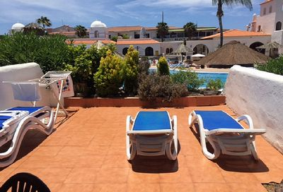 Spacious terrace with 4 sunbeds. Plus a covered area perfect for wining & dining