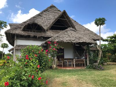Photo for Ras Nungwi Breezes  pretty cottage  in large  garden overlooking unspoilt beach