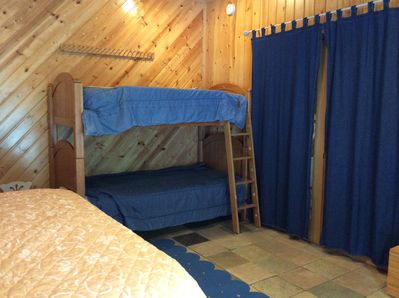 This room has twin bunks plus one twin.  Also, one king, so it sleeps 5 in beds.