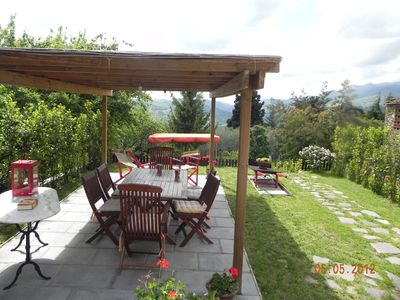 Large gazebo in the private garden, equipped with tables and chairs.