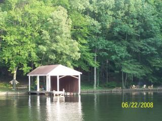 The home is waterfront with a boat house and dock.