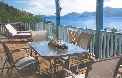 panoramic bay view covered deck patio with outside dining area