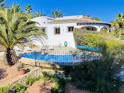 Photo for Sea views, walking distance to the beach and the beautiful town of Moraira make this an ideal four b