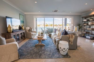 1st Floor Living Area w/ queen sized pull-out couch,  & waterfront dining table!
