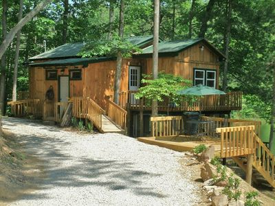 Photo for Beautiful cabin beside 7 acre lake that comes w/boat and deck overlooking water!