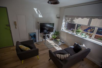 Ground floor apartment, the lounge room looks out onto a small garden