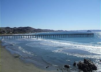 View of Cayucos Pier from condo deck.  Morro Rock can be seen in the background.