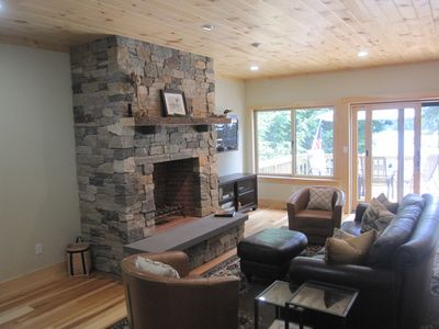 Living room on first floor looking out towards deck and Sebago Lake.