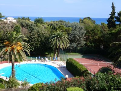 Photo for 700 meters from the BEACHES, NEAR NICE, CANNES, SWIMMING-POOL,TENNIS COURT, LOVELY APARTMENT with SEA-VIEW, GARAGE, VERY QUIET