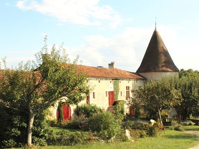 Photo for Farmhouse complex on an estate amid the scenic hills of the Périgord