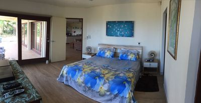 Main bedroom, air con Tv , overlooks pool, ocean and patio