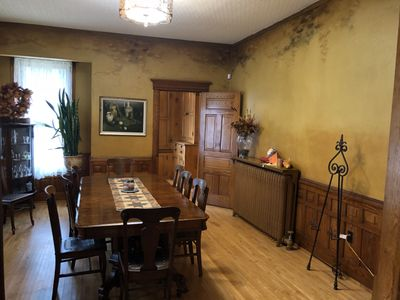 Dining room with hand-painted wallpaper