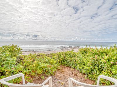 Photo for Panoramic views up and down the coast and a deck for enjoying the ocean air!
