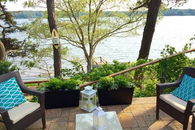 Waterfront on Follins Bay. Sit back on this beautiful stone patio and enjoy!