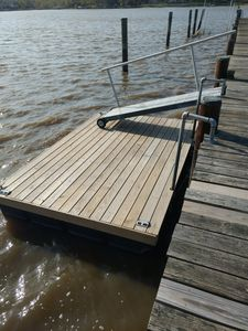 New floating dock gives easy access to the water.  Great for sunbathing too!