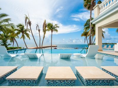 Photo for Crystal Waters: Luxury Contemporary Villa w/ New Pool, Barefoot Beach & Private Dock in Cayman Kai