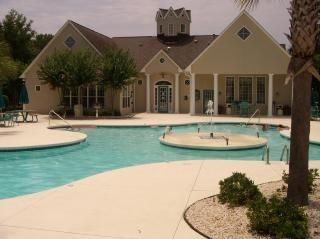 Clubhouse and pool area with outside grills and workout facility.