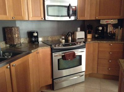 Kitchen, granite countertops, stainless appliances, ceramic tile floor