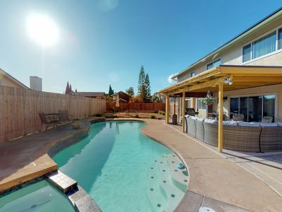 Photo for NEW LISTING! Colorful home w/ a private pool, furnished patio, & pool table!