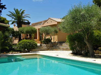 Photo for Cozy and luxurious house with pool and heavenly garden, few steps from the beach