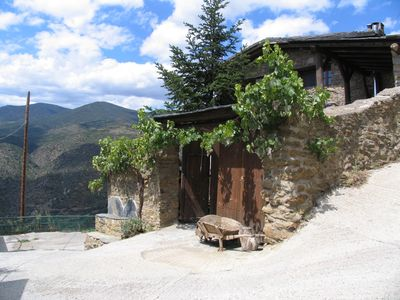 Photo for Panoramic views. In a small village in the Pyrenees. Private barbecue.