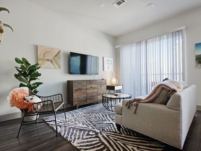 Photo for Chic condo located in city center - gym and shared pool!