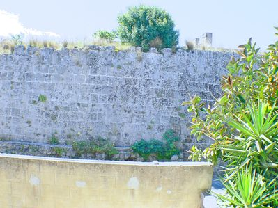 the view from bedroom window to the medieval city wall