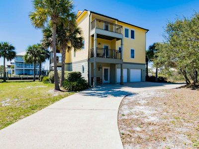 Photo for New Listing! Private Beach Home with 90' Boat Dock. Short Walk to the Beach!