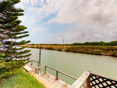 Photo for Bayfront cottage w/ porch, canal view & shared pools/hot tub/gym - 2 dogs OK!
