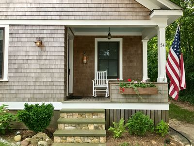Photo for Charmingly updated home with vintage character. Walk to beach and shops!