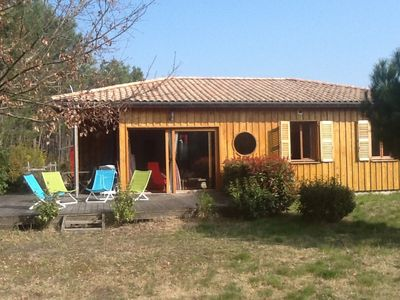 Photo for Beautiful wooden villa of 80m2. 900m2 ground. At the lake hourtin