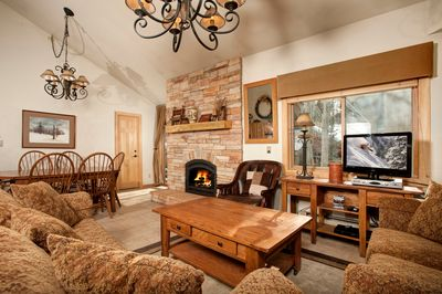 Take a seat in the comfortable living area, complete with cozy fireplace.