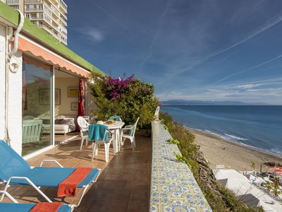 Photo for Precious Sea Front bungalow with sun terrace and stunning sea views.