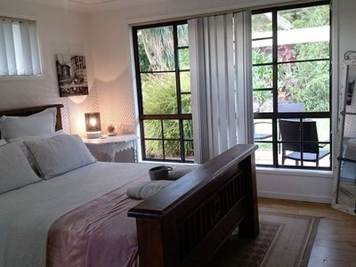 Main bedroom with Airconditioning and unique  floor to ceiling windows