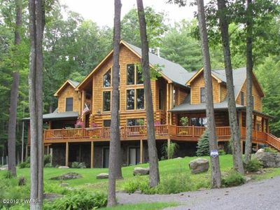 Photo for Luxury Lakefront Custom Log Home. Perfect for Ski Trips & Getaways!