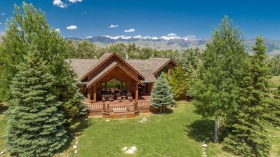 Photo for Gorgeous mountain lodge at the base of Emigrant Peak with pond, sleeps 8