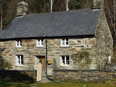 Photo for Romantic, 17c Listed Stone Cottage On Edge Of Lake In Ancient Oak Woodlands