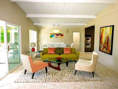 The spacious Conversation Area with gorgeous view of the pool/spa & backyard
