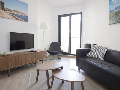Photo for Apartment Moraira center, swimming pool, balcony, wifi, A / C, Sonos, at the beach