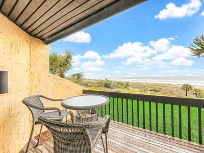 Photo for Oceanfront getaway with a shared pool & easy beach access