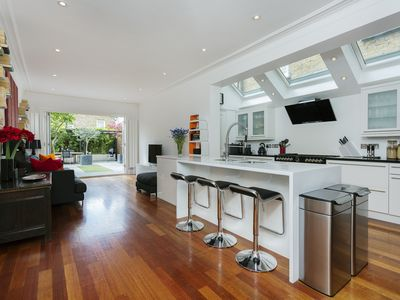 Photo for Light and modern 4 bed home moments from lush Clapham Common - Veeve