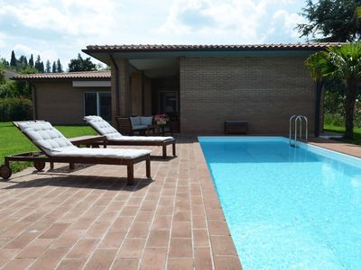 Photo for modern villa with pool and heated jacuzzi in Tuscany, nera Monte San savino and Cortona, a perfect place to relax and to strat for day trips all over the beautiful Tuscany. with air condition and wifi and playground for kids.