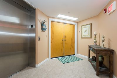 Entrance doors from your semi-private, secured foyer (shared with 1 other unit)