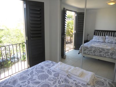 View from bedroom with sliding glass closet doors.