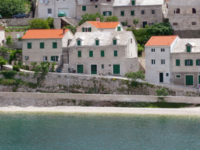 Photo for Beautiful holiday home on the island Brac, with the sea and a small beach in front of the door!